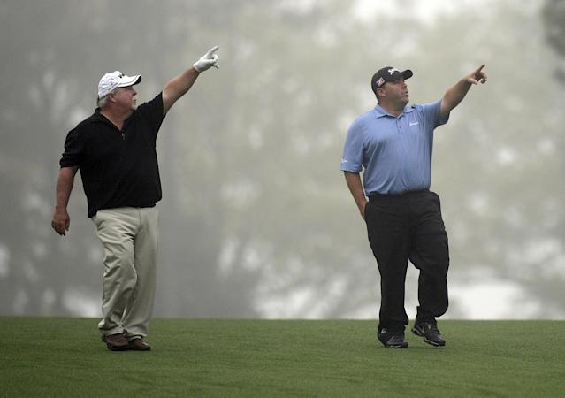 Craig Stadler and his son Kevin Stadler walk up a fairway during a practice round April 7, 2014 at Augusta National Golf Club in Augusta, Georgia (AFP Photo/Timothy A. Clary)