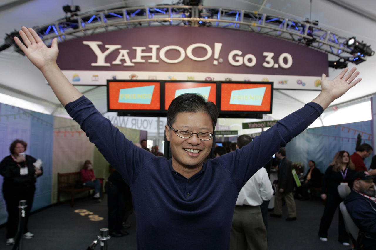 FILE - In this Jan. 7, 2008 file photo of Yahoo CEO Jerry Yang gestures in the Yahoo booth after he gave his keynote address at the Consumer Electronics Show (CES) in Las Vegas. Yang announced Tuesday, Jan. 17, 2012, that he is leaving Yahoo. The surprise departure comes just two weeks after Yahoo Inc. hired former PayPal executive Scott Thomson as its CEO. Yang expressed his support of Thompson in his resignation from Yahoo's board of directors. He had been on Yahoo's board since the company's 1995 inception. (AP Photo/Paul Sakuma, File)