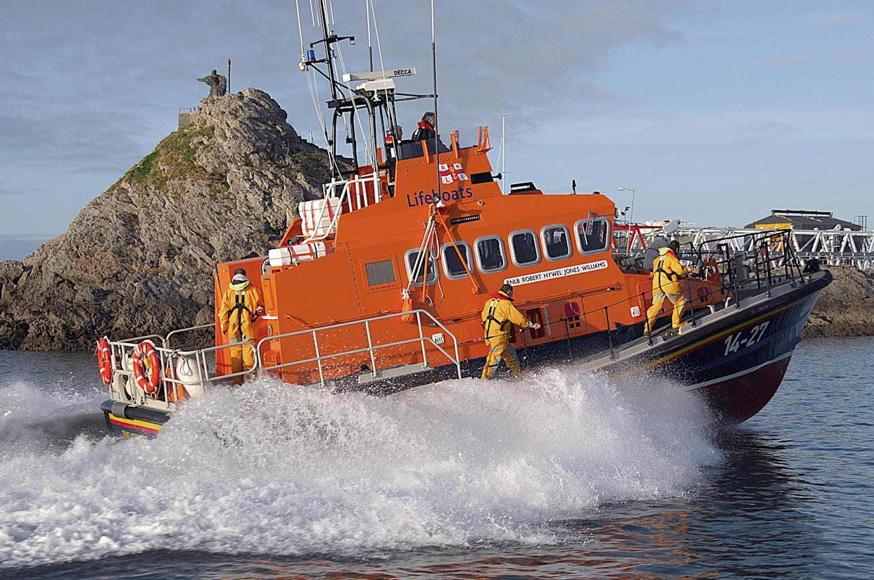 A swimmer was rescued by Fenit RNLI off the coast of Co Kerry in Ireland after being found surrounded by a pod of dolphins. (RNLI/Fenit)