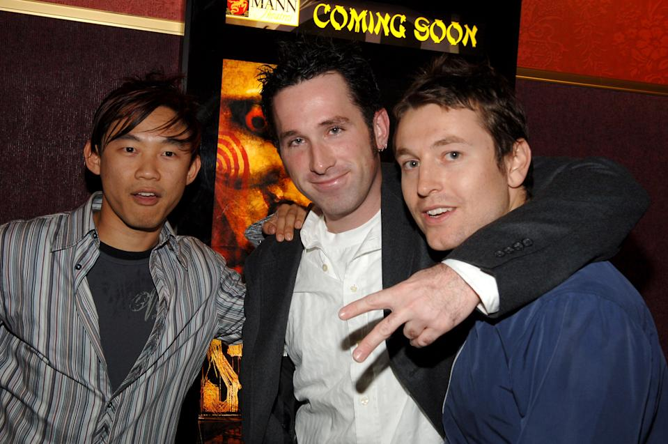 James Wan, Darren Lynn Bousman and Leigh Whannell attend a cast and crew screening for 'Saw II'. (Photo by J.Sciulli/WireImage for Lionsgate)