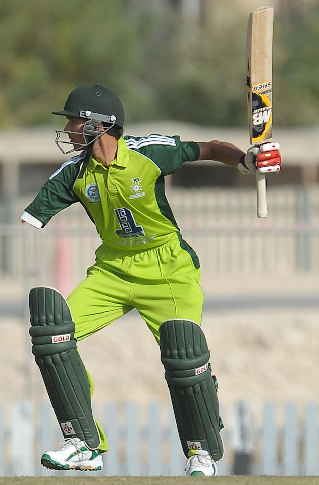 Pakistan disabled cricketer Matloob Qureshi plays a shot during the T20 match between England Disaballity team and Pakistan Disaballity team at the ICC Global Cricket Academy (ICC GCA) in Dubai Sports City on February 11, 2012. Pakistan beat England in the first-ever Twenty20 match between the physically challenged cricket teams by 14 runs in an exciting and emotional match. AFP PHOTO/ LAKRUWAN WANNIARACHCHI (Photo credit should read LAKRUWAN WANNIARACHCHI/AFP/Getty Images)