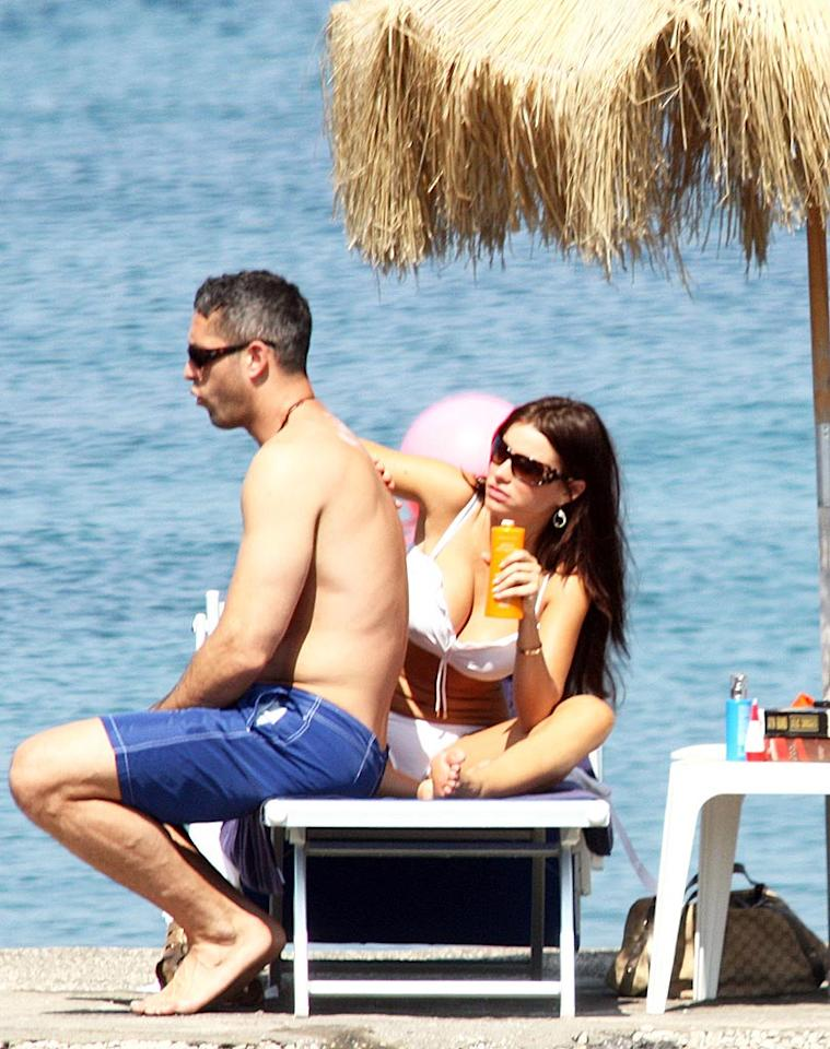 """""""Modern Family"""" star Sofia Vergara slathered sunblock on her main squeeze, Nick Loeb, while vacationing on the Isle of Ischia, which is the largest of three islands in the Bay of Naples. <a href=""""http://www.infdaily.com"""" target=""""new"""">INFDaily.com</a> - July 12, 2010"""