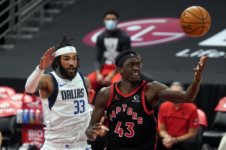 Toronto Raptors forward Pascal Siakam (43) loses the basketball as he tries to drive around Dallas Mavericks center Willie Cauley-Stein (33) during the second half of an NBA basketball game Monday, Jan. 18, 2021, in Tampa, Fla. (AP Photo/Chris O'Meara)