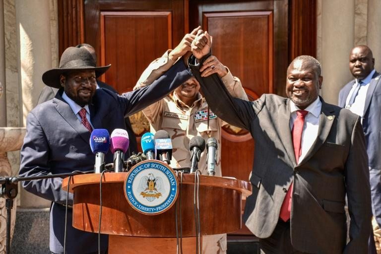 Bitter rivals Salva Kiir (left) and Riek Machar at talks last year which have finally produced a new government