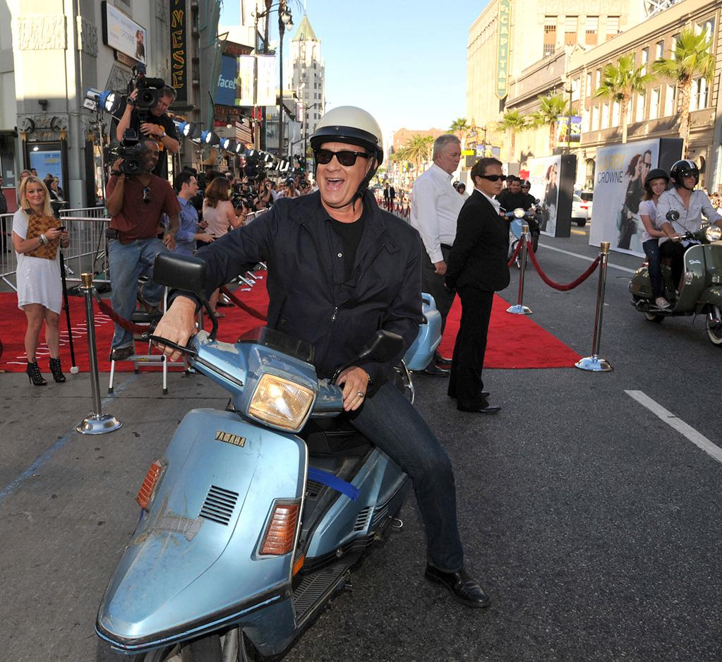 "<a href=""http://movies.yahoo.com/movie/contributor/1800010392"">Tom Hanks</a> at the Los Angeles premiere of <a href=""http://movies.yahoo.com/movie/1810196533/info"">Larry Crowne</a> on June 27, 2011."