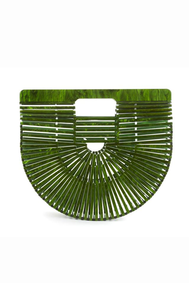 """<p><span><em>Hello, </em>perfect summer bag! You may recognize the shape—the bamboo versionby designerJasmin Larian<span></span>was a hit amongst street style stars and fashion editors alike—but this finish is brand new.<em></em><span></span>Sculptural, wearable, <em>and </em><span>affordable? That's a style trifecta we can get behind.</span>Keep an eye on Cult Gaia, because they're about to blow up with their forthcoming ready to wear collection too.</span></p><p>          <em>Cult Gaia Malachite Acrylic Ark, $298; <a rel=""""nofollow"""" href=""""https://cultgaia.com/collections/handbags/products/malachite-gaias-ark-preorder"""">cultgaia.com</a>  <span></span></em></p>"""