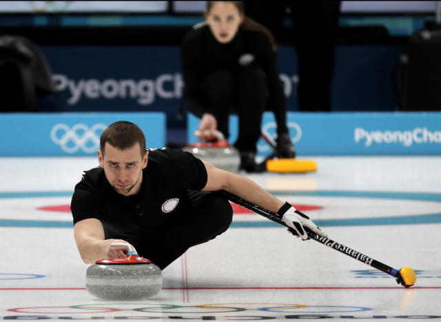 FILE - In this Feb. 7, 2018 file photo, Russian curler Alexander Krushelnitsky practices ahead of the 2018 Winter Olympics in Gangneung, South Korea. Krushelnitskys agent, Andrei Mitkov, said in a statement on Friday Jan. 11, 2019, that Alexander Krushelnitsky has dropped plans to appeal against his four-year ban after being stripped of a bronze medal for doping at 2018 Winter Olympics. (AP Photo/Aaron Favila, File)
