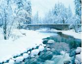 <p>The stone arch bridge along Merced River in Yosemite looks like a postcard thanks to the winter snow and the dark skies. While the river is clearly still running, ice makes it look glassy and clear. </p>