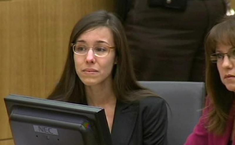 In this image made from pool video provided by APTN, Jodi Arias reacts during the reading of the verdict at Maricopa County Superior Court in Phoenix, Wednesday, May 8, 2013. Arias was convicted of first-degree murder in the gruesome killing of her one-time boyfriend in Arizona after a four-month trial that captured headlines with lurid tales of sex, lies, religion and a salacious relationship that ended in a blood bath. (AP Photo/APTN, Pool)