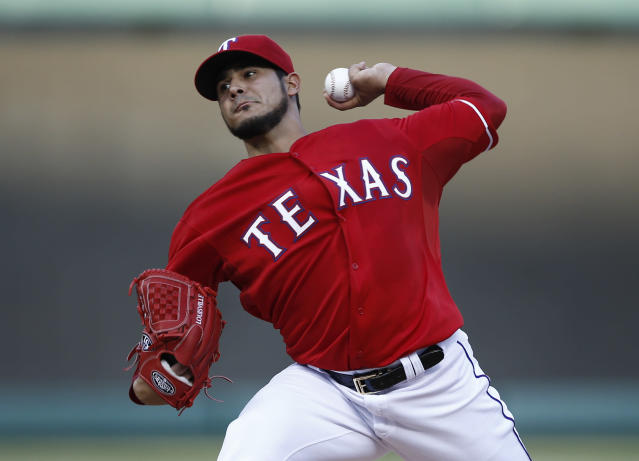 Texas Rangers starting pitcher Martin Perez throws to the Boston Red Sox during the first inning of a baseball game on Saturday, May 10, 2014, in Arlington, Texas. (AP Photo/Jim Cowsert)