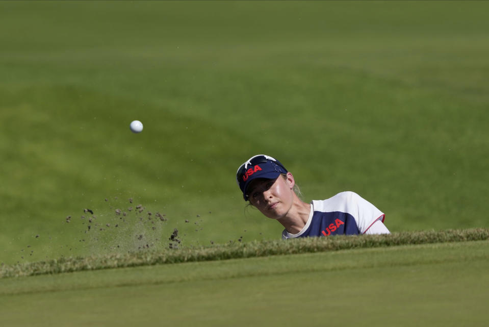 Nelly Korda, of the United States, plays a shot from a bunker on the 18th hole during the second round of the women's golf event at the 2020 Summer Olympics, Thursday, Aug. 5, 2021, at the Kasumigaseki Country Club in Kawagoe, Japan. (AP Photo/Andy Wong)