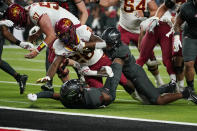 Iowa State running back Breece Hall (28) is tackled by UNLV linebacker Jacoby Windmon, right, near the goal line during the first half of an NCAA college football game Saturday, Sept. 18, 2021, in Las Vegas. (AP Photo/John Locher)
