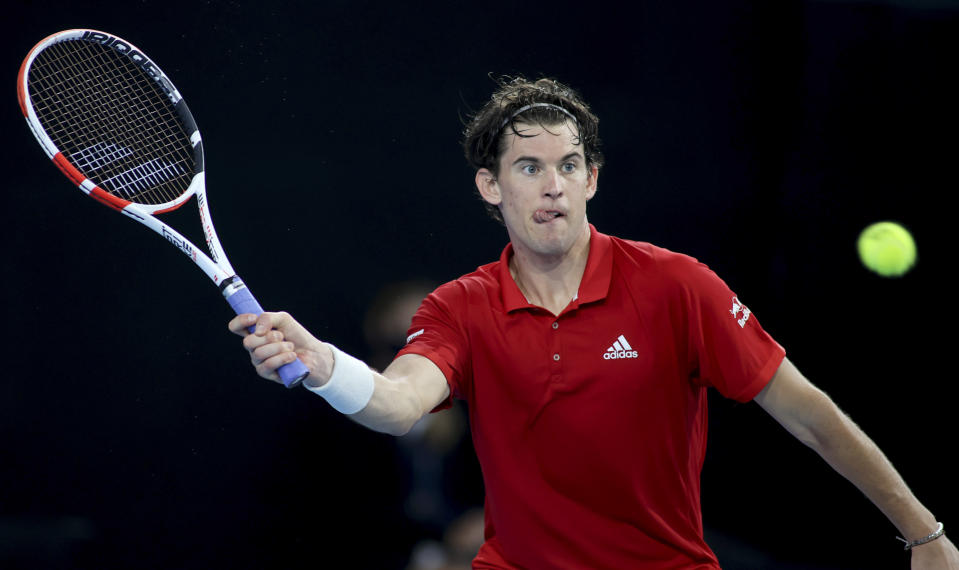 Austria's Dominic Thiem makes a forehand return to Spain's Rafael Nadal during an exhibition tennis event in Adelaide, Australia, Friday, Jan 29. 2021. (Kelly Barnes/AAP Image via AP)