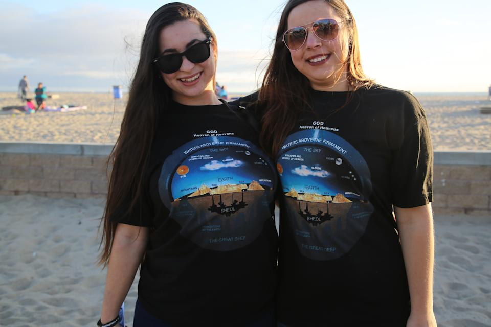 *** EXCLUSIVE - VIDEO AVAILABLE ***  ORANGE COUNTY, CALIFORNIA - MARCH 25: Two women wearing Flat Earth t-shirts at a Flat Earther meet-up on March 25, 2017, in Orange County, California.   THERE is an ever-growing community of people who reject scientific wisdom and insist that the world is FLAT. Nathan Thompson, 31, a network marketer based in Orange County, California, set up the Official Flat Earth and Globe Discussion group on Facebook in June 2016. The group now boasts more than 42,000 members and even Nathan has been taken aback by its rapid growth. These Flat Earthers believe that our planet is encircled by a giant, heavily-policed ice wall and that gravity is just an unproven theory. They also claim that NASA is a fraudulent organisation and that all the photographs and video footage we have from space are computer-generated imagery (CGI). And while their views may sound far-fetched, the movement has attracted a number of celebrity adherents in recent months, including rapper B.o.B., former reality TV star Tila Tequila and basketball legend Shaquille ONeal.  PHOTOGRAPHY BY Joel Forrest / Barcroft Images  London-T:+44 207 033 1031 E:hello@barcroftmedia.com - New York-T:+1 212 796 2458 E:hello@barcroftusa.com - New Delhi-T:+91 11 4053 2429 E:hello@barcroftindia.com www.barcroftimages.com (Photo credit should read Joel Forrest / Barcroft Media via Getty Images / Barcroft Media via Getty Images)