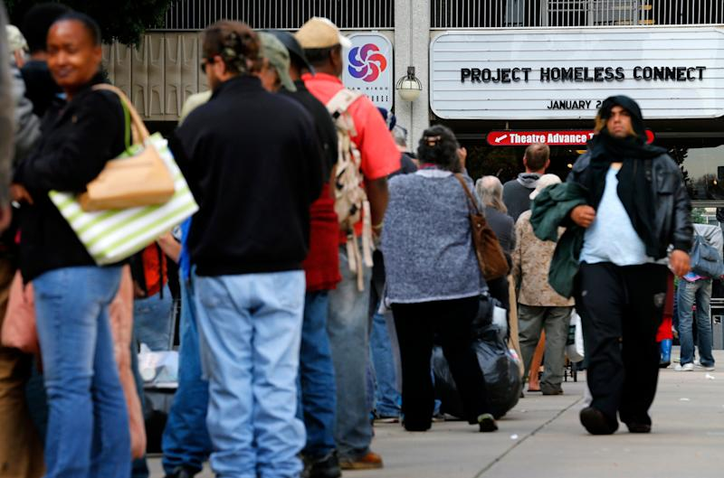Homeless families and individuals line up to attend Project Homeless Connect in San Diego in 2015, a one-day resource fair. Local officials are trying to find ways to address an outbreak of hepatitis A.