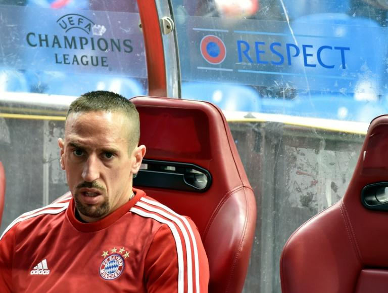 Bayern Munich's midfielder Franck Ribery sits on the bench during the UEFA Champions League semifinal match in Madrid on April 27, 2016