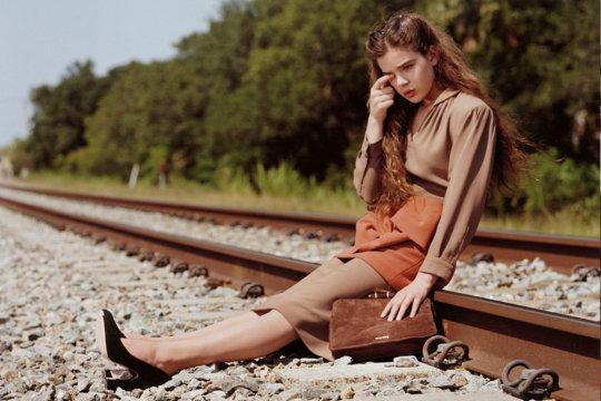 """<p>At 14, Hailee Steinfeld was tapped to front Miu Miu's ad campaign. While the teenager's Miucca Prada-designed outfit was conservative and age-appropriate in a brown knee-length dress, the ASA took issue with the setting. The watchdog ruled in November 2011 that the Bruce Weber-shot image placed Steinfeld """"in a potentially hazardous situation sitting on a railway track,"""" and therefore """"concluded the ad was irresponsible and in breach of the code in showing a child in a hazardous or dangerous situation."""" Parent company Prada fired back saying that she """"was not crying, nor had she been asked to cry or look upset"""" and since the photos were taken on an abandoned rail track, she wasn't in danger. Additionally, the company added that the actress was part of """"a serious, high-fashion campaign aimed at adult women"""" and the ad was only featured in adult, not teen-skewing publications.</p>"""