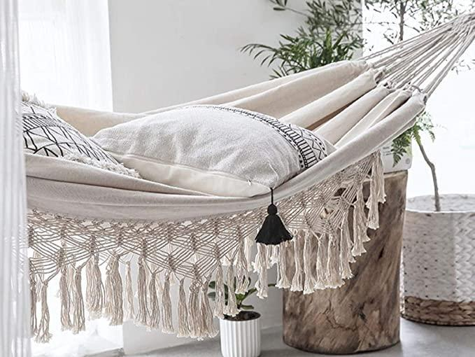 """<h2>Best Hammock For Indoors</h2><br><h3>Terracotta Door Boho Hammock For 2 Adults</h3><br><strong>The Hype:</strong> 4.7 out of 5 stars and 64 ratings<br><br><strong>Reviewers say:</strong> """"Love it. Looks great. Ours is inside and would probably get very dirty if left outside. Works perfect for an indoor hammock.""""<br><br><em>Shop</em> <strong><em><a href=""""https://amzn.to/3wD9zbm"""" rel=""""nofollow noopener"""" target=""""_blank"""" data-ylk=""""slk:Terracotta Door"""" class=""""link rapid-noclick-resp"""">Terracotta Door</a></em></strong><br><br><br><br><strong>Terracotta Door</strong> Boho Hammock for 2 Adults, $, available at <a href=""""https://amzn.to/3B0moQs"""" rel=""""nofollow noopener"""" target=""""_blank"""" data-ylk=""""slk:Amazon"""" class=""""link rapid-noclick-resp"""">Amazon</a>"""