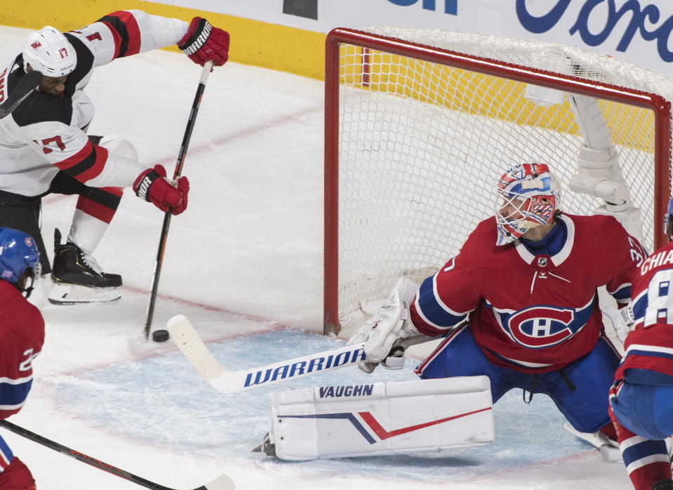 New Jersey Devils' Wayne Simmonds scores against Montreal Canadiens goaltender Keith Kinkaid during the third period of an NHL hockey game in Montreal, Saturday, Nov. 16, 2019. (Graham Hughes/The Canadian Press via AP)