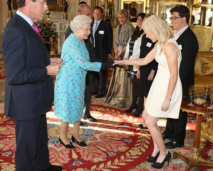 """<div class=""""caption-credit""""> Photo by: Getty Images</div><div class=""""caption-title"""">Meeting the Queen during the Young People and The Performing Arts last May</div>Looking perfectly ladylike, Goulding graciously shook hands with Elizabeth II in an a-line white cocktail dress with simple black laser cut heels."""