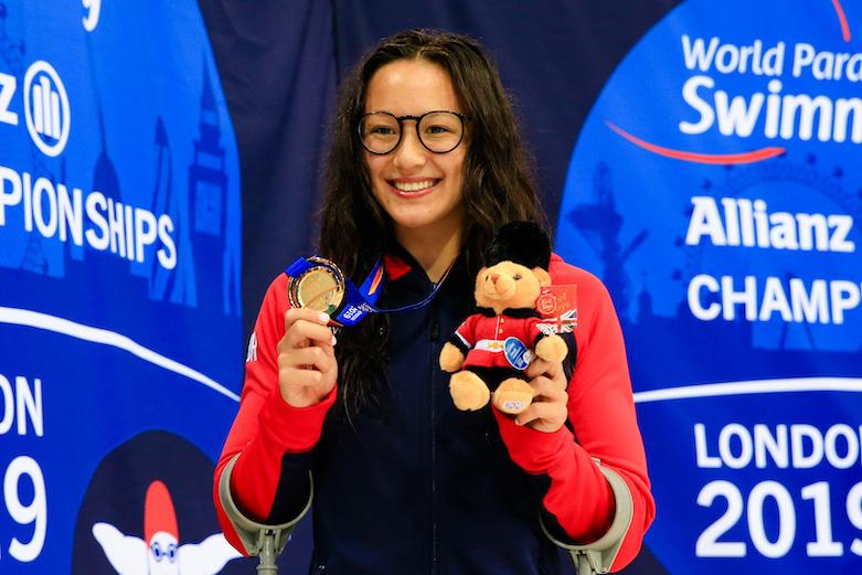 Alice Tai celebrates her gold medal on a successful night for British swimmers at the World Para Swimming Championships