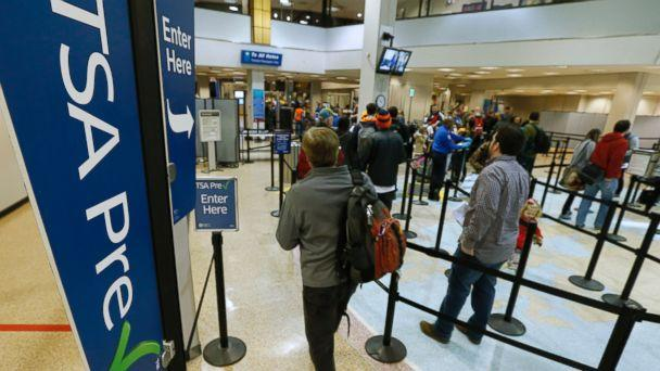 PHOTO: A passenger enters the Transportation Security Administration (TSA) pre-check line towards a security check point at Salt Lake City International Airport in Salt Lake City, on Dec. 23, 2014. (George Frey/Bloomberg via Getty Images)