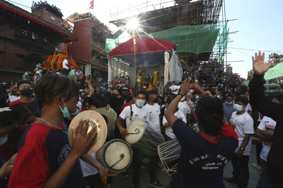 Devotees play traditional drums during the annual Indra Jatra festival in Kathmandu, Nepal, Sunday, Sept. 19, 2021. The feast of Indra Jatra marks the return of the festival season in the Himalayan nation two years after it was scaled down because the pandemic. (AP Photo/Niranjan Shrestha)