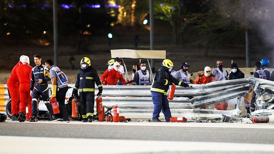 Officials, pictured here clearing debris from the track after Romain Grosjean's scary crash.