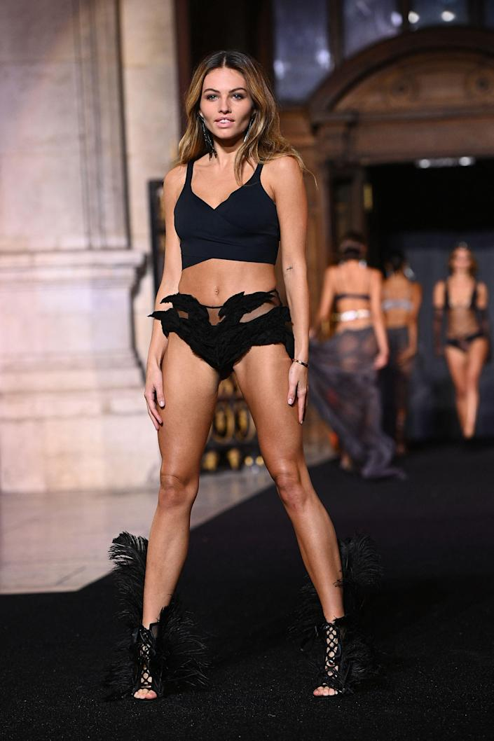 """French model Thylane Blondeau presents a creation by designer Etam during Paris Fashion Week at the Garnier Opera in Paris. <span class=""""copyright"""">Photo by Christophe ARCHAMBAULT / AFP via Getty Images</span>"""