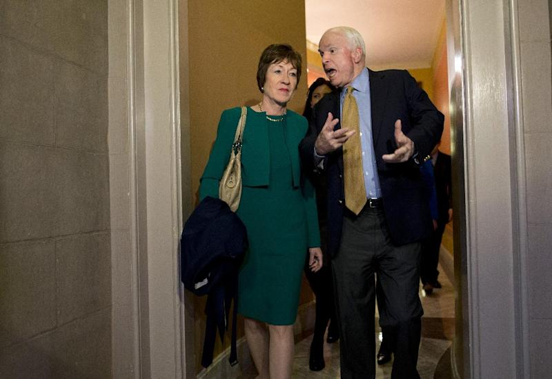 Sen. John McCain, R-Ariz., right, talks with Sen. Susan Collins, R-Maine, after arriving on Capitol Hill in Washington, Friday, Oct. 11, 2013, following after a meeting between Republican senators and President Obama at the White House on the ongoing budget battle. Republicans from the House of Representatives were offering to pass legislation to avert a potentially catastrophic default and end the 11-day partial government shutdown as part of a framework that would include cuts in benefit programs, officials said Friday. But the impasse was not yet over. (AP Photo/ Evan Vucci)