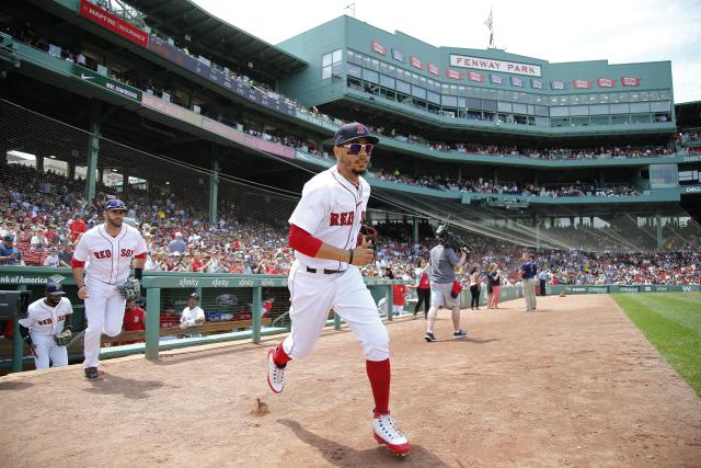 Boston Red Sox's Mookie Betts takes the field before a baseball game against the Toronto Blue Jays Saturday, July 14, 2018, in Boston. (AP Photo/Winslow Townson)