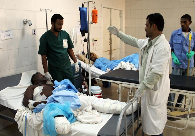 Wounded men receive medical attention in the Sadaka hospital in Aden, the largest city in southern Yemen, on July 5, 2015. Overwhelmed by the flood of sick and injured of a long conflict, Aden hospitals became hospices due to lack of beds and medicine. More than 21.1 million people -- over 80 percent of Yemen's population -- are in need of aid, with 13 million facing food shortages. More than 2,800 people have been killed in the impoverished Arabian Peninsula country since March, according to UN figures. AFP PHOTO / SALEH OBEIDI (AFP Photo/Saleh al-Obeidi)