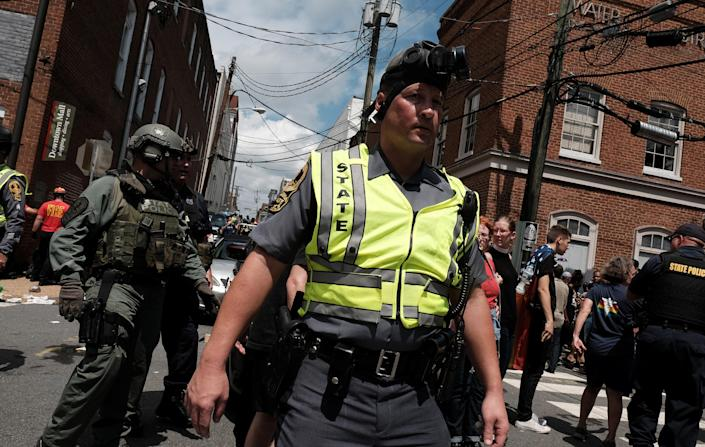 """<p>Police respond after a car drove through a group of counter protesters at the """"Unite the Right"""" rally Charlottesville, Va., Aug. 12, 2017. (Photo: Justin Ide/Reuters) </p>"""