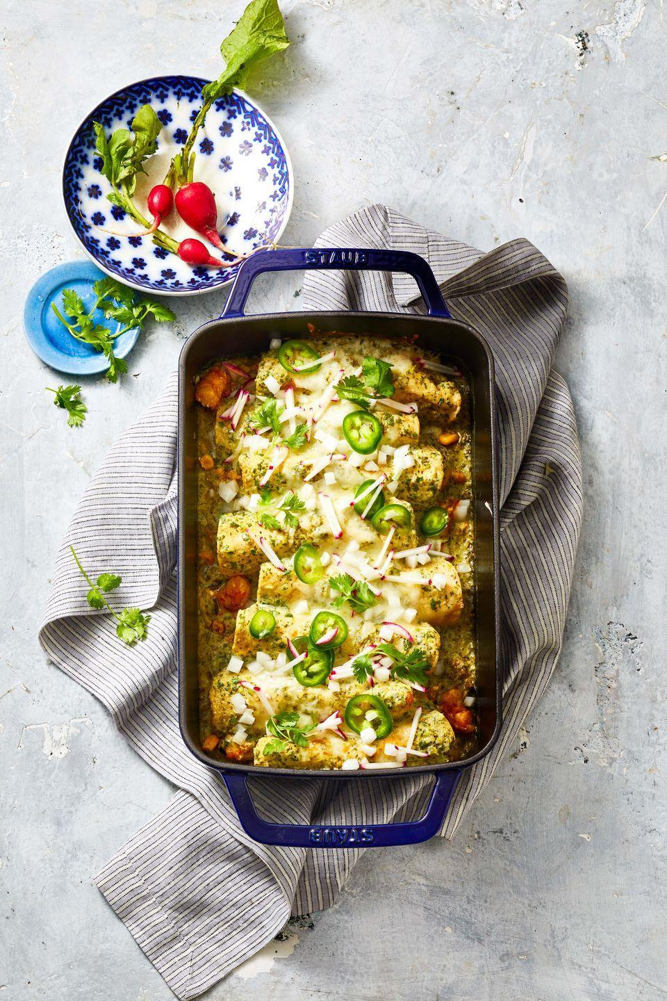 """<p>Make a quick enchilada sauce of store-bought salsa verde, cilantro and sour cream and you'll get this vibrant recipe on the table in under 40 minutes (really!).</p><p><em><a href=""""https://www.goodhousekeeping.com/food-recipes/a36323456/shrimp-zucchini-and-corn-enchiladas-recipe/"""" rel=""""nofollow noopener"""" target=""""_blank"""" data-ylk=""""slk:Get the recipe for Shrimp Enchiladas With Zucchini and Corn »"""" class=""""link rapid-noclick-resp"""">Get the recipe for Shrimp Enchiladas With Zucchini and Corn »</a></em></p>"""