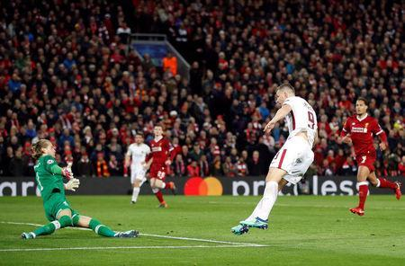 Soccer Football - Champions League Semi Final First Leg - Liverpool vs AS Roma - Anfield, Liverpool, Britain - April 24, 2018 Roma's Edin Dzeko scores their first goal Action Images via Reuters/Carl Recine