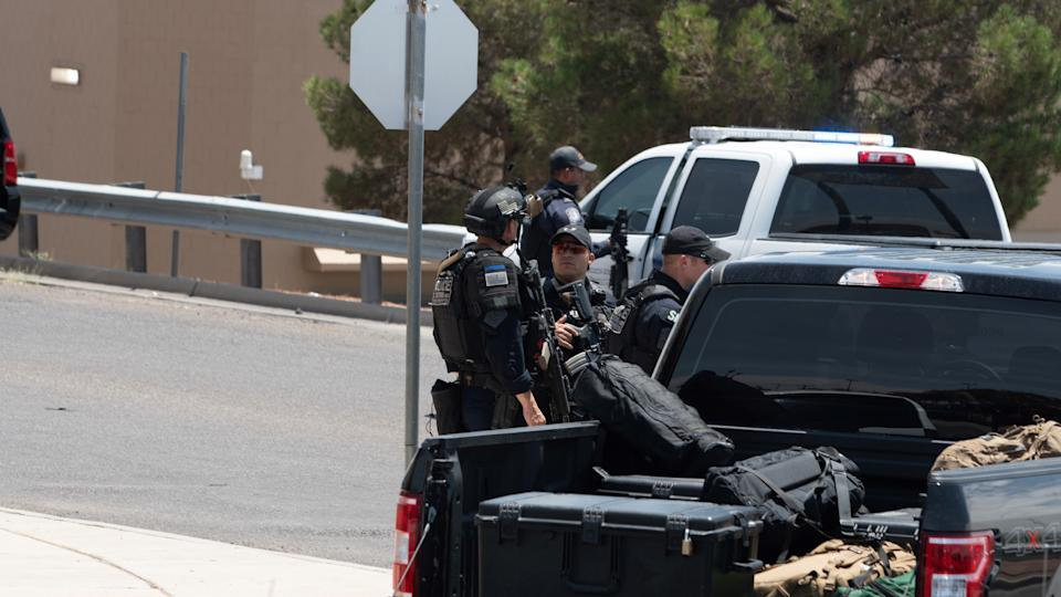 TEXAS, USA - AUGUST 03: Police officers take security measures at the scene of shooting incident at a Walmart in El Paso, Texas, United States on August 03, 2019. Reports state that at least 10 people have been killed and 30 are injured. Police say that one male suspect is in custody. Local media reports say there were at least 18 wounded, including some in critical condition, adding that many police vehicles and ambulances were dispatched to the scene. (Photo by Jonathan Yturales /Anadolu Agency via Getty Images)