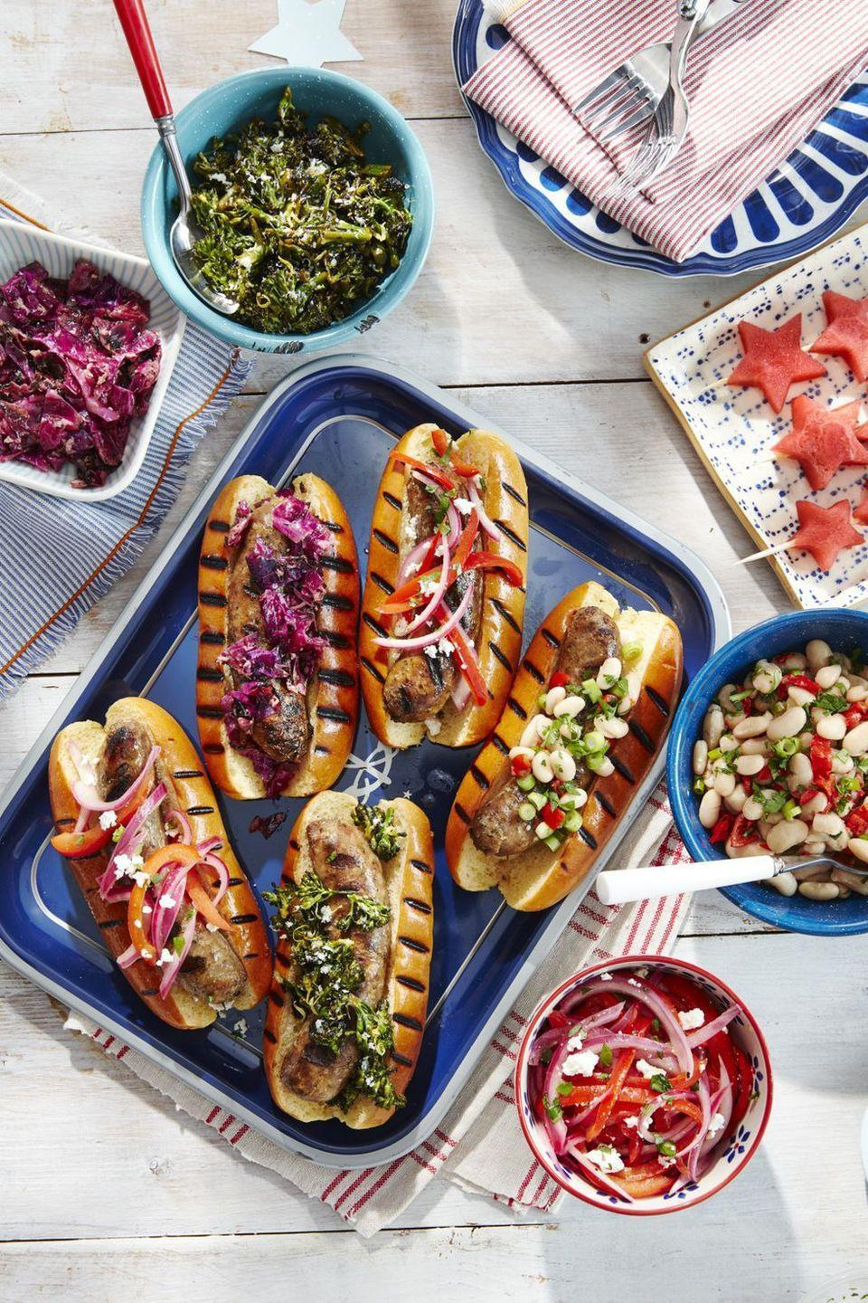 "<p>Just look at those grill marks. Dreamy! Add your favorite toppings, and a platter of these sausages will win you ""host of the year.""</p><p><strong><a href=""https://www.countryliving.com/food-drinks/a28188266/grilled-sausages-recipe/"" rel=""nofollow noopener"" target=""_blank"" data-ylk=""slk:Get the recipe"" class=""link rapid-noclick-resp"">Get the recipe</a>.</strong></p><p><strong><a class=""link rapid-noclick-resp"" href=""https://www.amazon.com/Reston-Lloyd-Melamine-Rectangular-Turquoise/dp/B000UOG83Y/?tag=syn-yahoo-20&ascsubtag=%5Bartid%7C10050.g.3663%5Bsrc%7Cyahoo-us"" rel=""nofollow noopener"" target=""_blank"" data-ylk=""slk:SHOP SERVING TRAYS"">SHOP SERVING TRAYS</a></strong></p>"