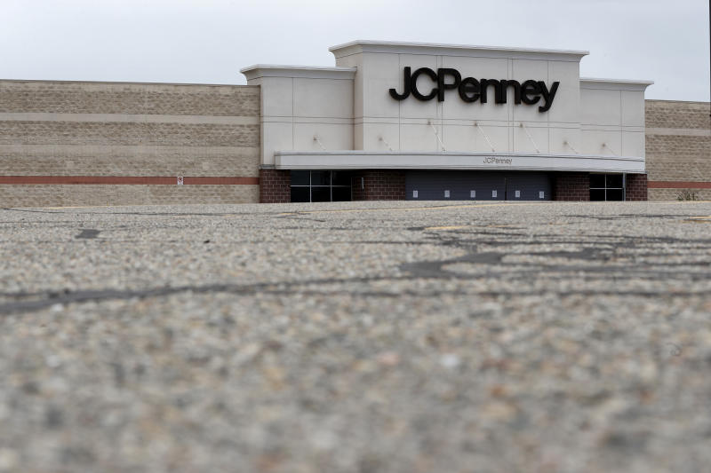 An empty parking lot is shown at a closed JCPenney store in Roseville, Mich., Friday, May 8, 2020. Across the country, in industries of every kind and size, the coronavirus COVID-19 pandemic has devastated businesses small and large. (AP Photo/Paul Sancya)