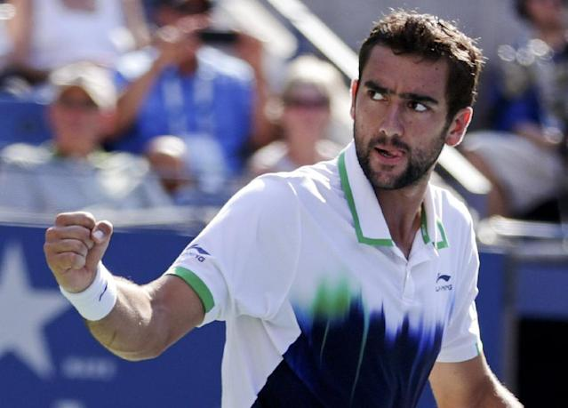 Marin Cilic, of Croatia, reacts after winning a game against Tomas Berdych, of the Czech Republic, during the quarterfinals of the 2014 U.S. Open tennis tournament, Thursday, Sept. 4, 2014, in New York. (AP Photo/Julio Cortez)