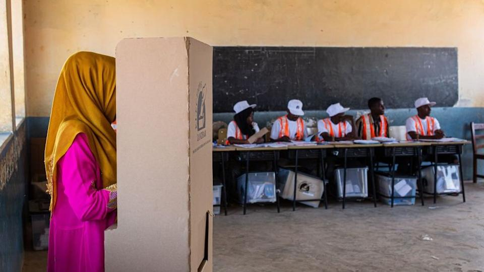 A woman fills in her her special ballot in a voting booth at Mtupepo Primary School in Daraja Bovu, Zanzibar, on October 27, 2020.