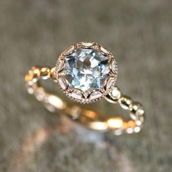 """<i>Buy it from<a href=""""https://www.etsy.com/listing/487618217/14k-rose-gold-floral-aquamarine?ga_search_query=vintage&ref=shop_items_search_19"""" target=""""_blank"""">LaMoreDesign on Etsy</a>for $898+.</i>"""