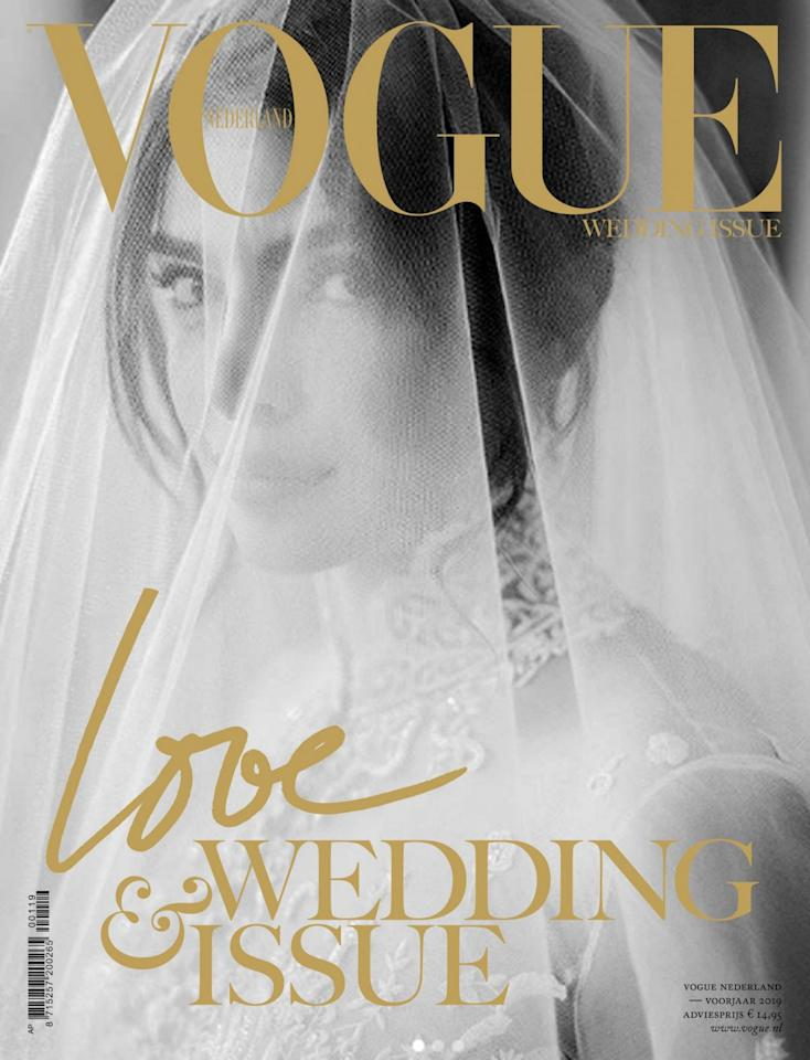 A surreal black and white photo of Priyanka Chopra, from her white wedding, featured on the cover of Vogue Netherland's Wedding Issue. The actress wore a Ralph Lauren gown for her wedding with singer Nick Jonas.