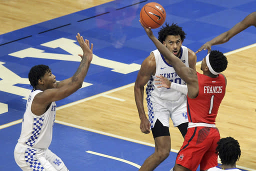 Richmond's Blake Francis (1) shoots near Kentucky's Cam'Ron Fletcher, left, and Olivier Sarr during the second half of an NCAA college basketball game in Lexington, Ky., Sunday, Nov. 29, 2020. (AP Photo/James Crisp)