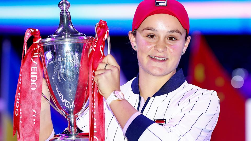 Ash Barty, pictured here with the Billie Jean King trophy after winning the WTA Finals in 2019.
