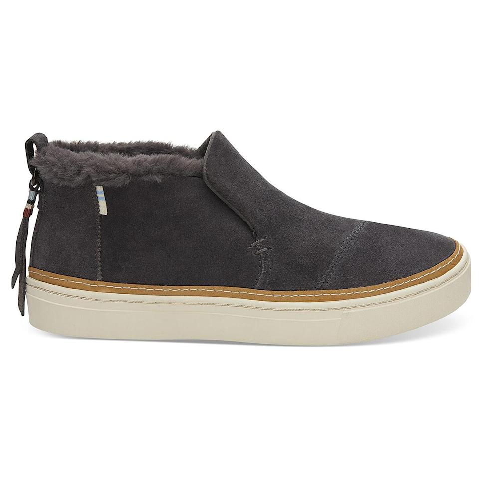 """<p><strong>Buy It!</strong> <a href=""""https://www.toms.com/us/women/shoes/slip-ons/sable-leather-and-faux-fur-womens-paxton-slip-ons/10016046.html"""" rel=""""nofollow noopener"""" target=""""_blank"""" data-ylk=""""slk:&quot;Paxton&quot; Boot, $84.95; toms.com"""" class=""""link rapid-noclick-resp"""">""""Paxton"""" Boot, $84.95; toms.com</a></p>"""