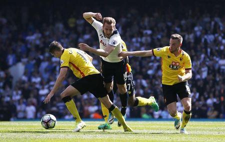Britain Football Soccer - Tottenham Hotspur v Watford - Premier League - White Hart Lane - 8/4/17 Tottenham's Harry Kane is fouled by Watford's Craig Cathcart  Action Images via Reuters / Paul Childs Livepic