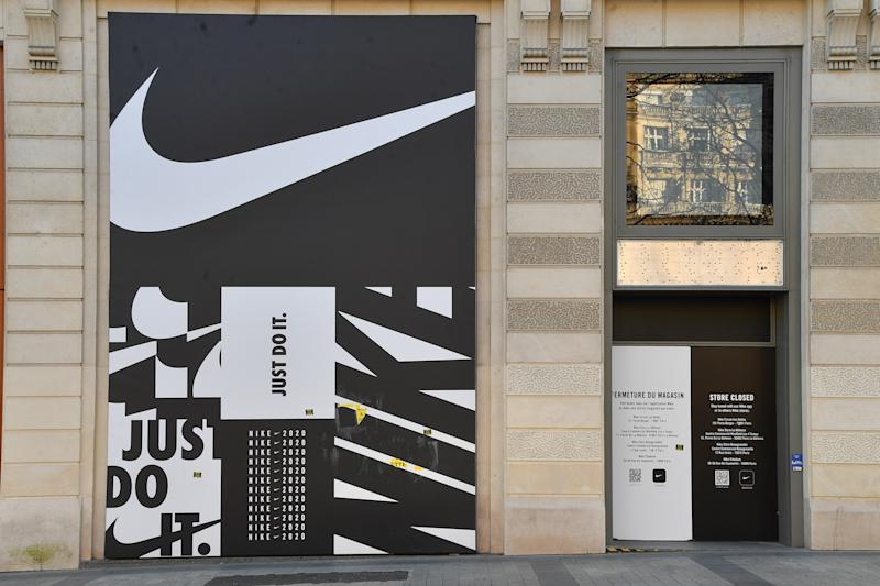 PARIS, FRANCE - MARCH 30: View of closed Nike store on the Champs Elysees during the Coronavirus epidemic on March 30, 2020 in Paris, France. The country is fining people caught in violation of its national lockdown measures to stop the spread of COVID-19. The pandemic has spread to at least 182 countries, killing more than 37,000 and infecting hundreds of thousands more. (Photo by Stephane Cardinale - Corbis/Corbis via Getty Images)