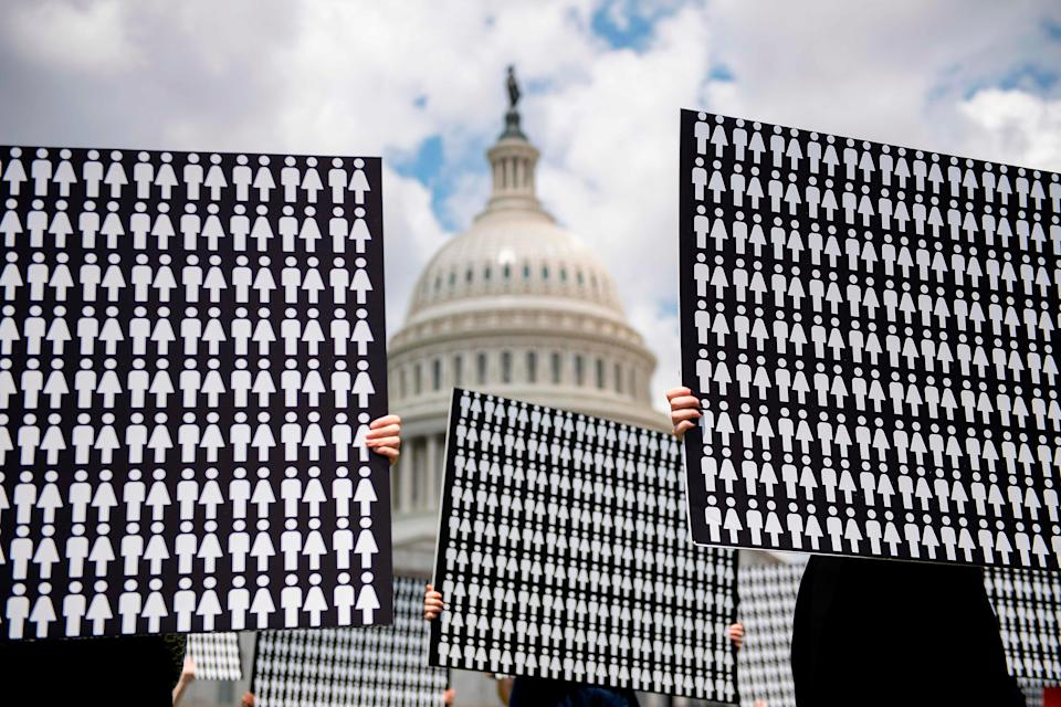 Demonstrators hold up placards representing the number of the people who have died due to gun violence on Capitol Hill in Washington, DC, on June 20, 2019, during an event with gun violence prevention advocates.