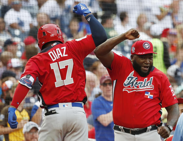 World Team Yusniel Diaz, of the Los Angles Dodgers, left, celebrates his home run with World Team manager David Ortiz in the seventh inning of the All-Star Futures baseball game against the U.S. Team, Sunday, July 15, 2018, at Nationals Park, in Washington. The the 89th MLB baseball All-Star Game will be played Tuesday. (AP Photo/Alex Brandon)