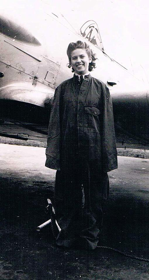 "<p class=""MsoNormal"" style=""""><span>Julia Boyd wearing an oversized flightsuit in front of a Harvard training aircraft. Photo courtesy of </span><a target=""_blank"" href=""http://www.thememoryproject.com/stories/2314:julia-boyd/"">Historica-Dominion Institute</a>. </p>"